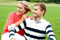 Woman pointing at her lovable husband - stock photo