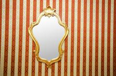 Ornate mirror on the wall Stock Photos