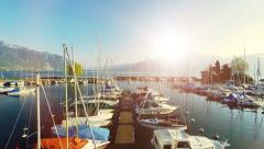 Magic hour sunset. aerial view.water lake.sailboats dock pier.panorama horizon. Stock Footage