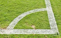 green grass and soccer field corner - stock photo