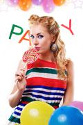 Pinup girl with lollipop, baloons and party word - stock photo