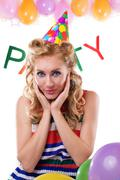 Surprised pinup girl with baloons and party word - stock photo