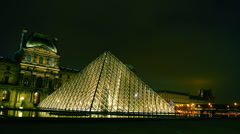 The Louvre and the pyramid in night,time lapse view,4k to multimedia Stock Footage