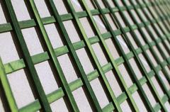 Green wooden lattice wall - stock photo