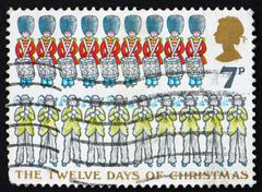 Postage stamp GB 1977 Nine Drummers Drumming and Ten Pipers Pipi - stock photo