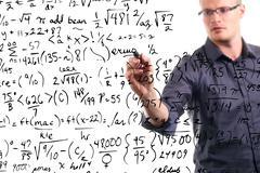 man writes mathematical equations on whiteboard - stock illustration