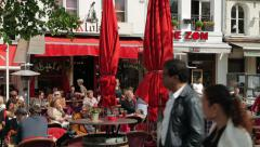 People sit at restaurant and cafe, antwerp, belgium Stock Footage