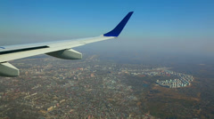 Aerial view from the cabin porthole of an airliner Stock Footage