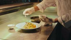 6of27 Restaurant kitchen with chef cooking food, cook at work Stock Footage
