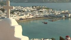 Cross in front of Mykonos Island in Greece Stock Footage