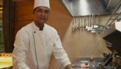 7of27 Restaurant kitchen with asian chef cooking food, cook working Stock Footage