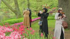 Islam, muslim women visit tulips, keukenhof, holland, the netherlands Stock Footage