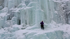 Ice climber frozen waterfall nr Kuusamo Lapland Finland Stock Footage