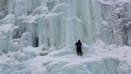 Stock Video Footage of Ice climber frozen waterfall nr Kuusamo Lapland Finland