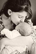 Mother loving her baby Stock Photos