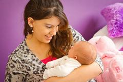 mother loving her baby - stock photo