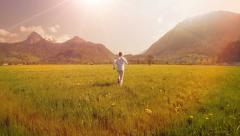 Man running on grass field. person. male. leisure activity. recreational Stock Footage
