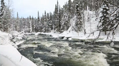 Fast flowing river winter snow Juuma Oulanka Nat Pk Finland slow motion Stock Footage