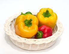 fresh sweet  paprika in wood basket. - stock photo