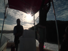Silhouette of driver and tourist on fast boat, people or person in shot, HD, Stock Footage