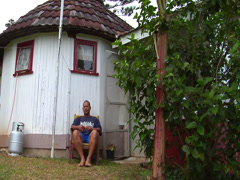 Tongan man sitting outside cottage, people or person in shot, HD, UP15507 - stock footage