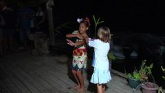 Tongan girl dancing with tourists sticking money to her, people or person in Stock Footage