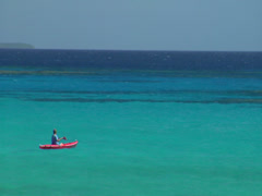 Kayak paddling over blue water, people or person in shot, HD, UP15680 - stock footage