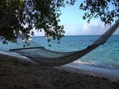Silhouetted hammock on the beach, HD, UP15859 - stock footage