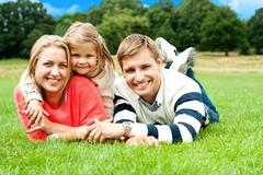 Joyous family in a park enjoying day out - stock photo