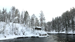 Riverside cabin nr Myllykoski rapids Juuma, Oulanka Nat Pk Finland Stock Footage