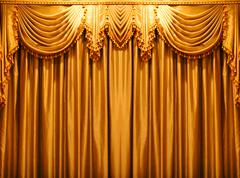 Luxury gold fabric curtains backdrop on the theater Stock Photos