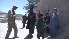 Army Afghanistan Soldiers Speak To Civilian - stock footage