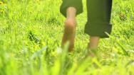 Stock Video Footage of Child running barefoot on grass