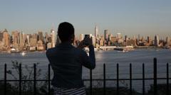Woman Smartphone Instagram Photos of Manhattan New York Skyline Stock Footage