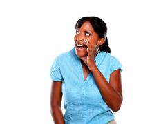 Afro-american woman screaming on blue shirt - stock photo
