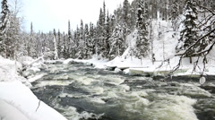 Fast flowing river winter snow Juuma Oulanka Nat Pk Kuusamo, Finland Stock Footage
