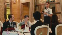 10of27 People, friends, businessmen, businesswomen at restaurant, dinner, server Stock Footage