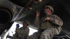 US Army Infantry soldiers prepare a Aircraft with C 4 Stock Footage