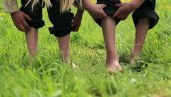 Child running barefoot on grass Stock Footage