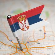 Serbia Small Flag on a Map Background. - stock illustration