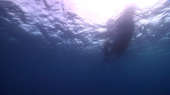 Distant scuba diver in bluewater, HD, UP17358 Stock Footage