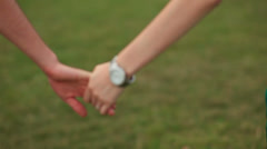 Detail of two lovers joining hands Stock Footage