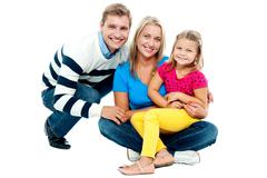 Portrait of happy couple smiling with cute daughter - stock photo