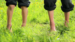 Baby foot jumping in the grass Stock Footage