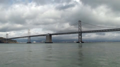 San Francisco - Oakland Bay Bridge as seen from the Embarcadero. Stock Footage