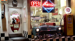 Vintage style Showcase of Lori's Diner Mason at night. San Francisco - stock footage