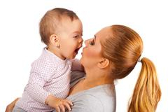 Mother and amazed baby girl Stock Photos