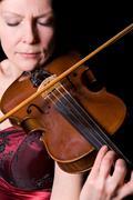 Young woman plays the viola Stock Photos