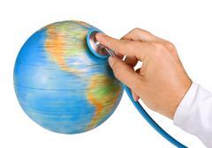 doctor examine the earth - stock photo