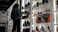 Buyer in the shoestore.  NYC, USA. - stock footage